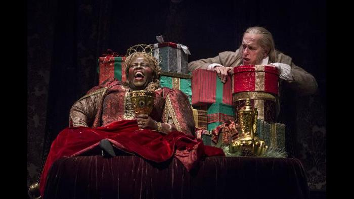 "Lisa Gaye Dixon as the Ghost of Christmas Present and Larry Yando as Ebenezer Scrooge in ""A Christmas Carol"" at the Goodman Theatre. (Photo: Liz Lauren)"