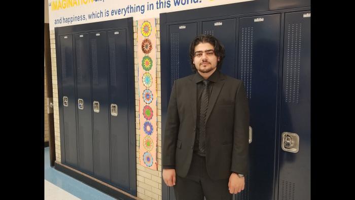 Alaaulldin Al Ibrahim inside Roger C. Sullivan High School. (Matt Masterson / WTTW News)