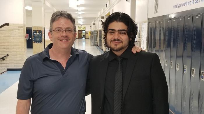 Alaaulldin Al Ibrahim and Sullivan teacher Tony Smith. (Matt Masterson / WTTW News)