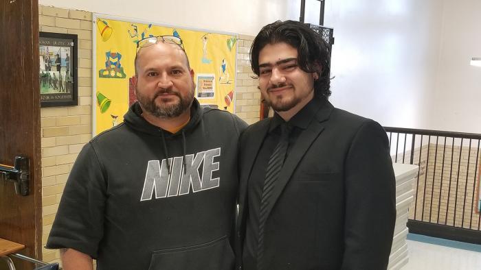 Alaaulldin Al Ibrahim and Sullivan teacher Steve Saa. (Matt Masterson / WTTW News)