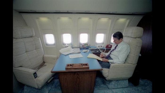 Ronald Reagan in a customary pose, working on his trusty yellow tablet in the stateroom aboard Air Force One, February 19, 1981