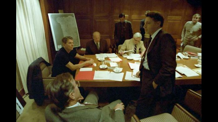 Evening meeting in the Sit Room to discuss Lebanon Marine barracks bombing with George Bush, George Shultz, Caspar Weinberger, and senior staff of National Security Planning Group, October 23, 1983 Bud McFarlane and George Shultz brief Ronald Reagan on the situation in Grenada, Eisenhower Cabin, Augusta Golf Course, October 22, 1983.
