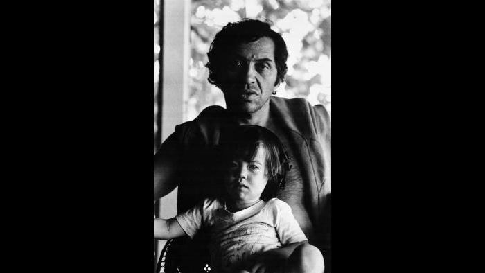 Bill Graham relaxes at home with son Alex in 1978. (Marcia Sult Godinez / Collection of David and Alex Graham)