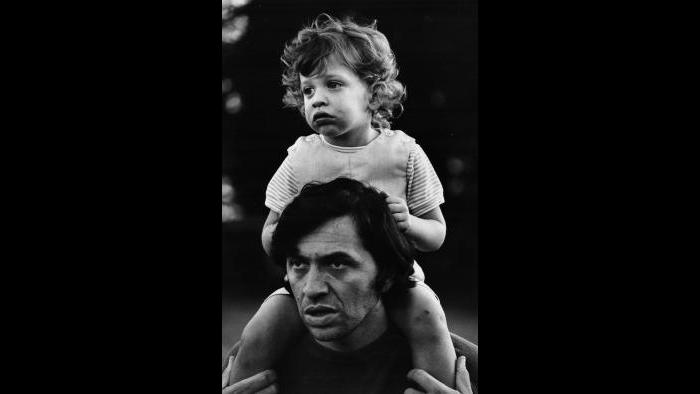 Bill Graham gives his young son David a piggyback ride, 1969. (Bonnie MacLean / Collection of David and Alex Graham)