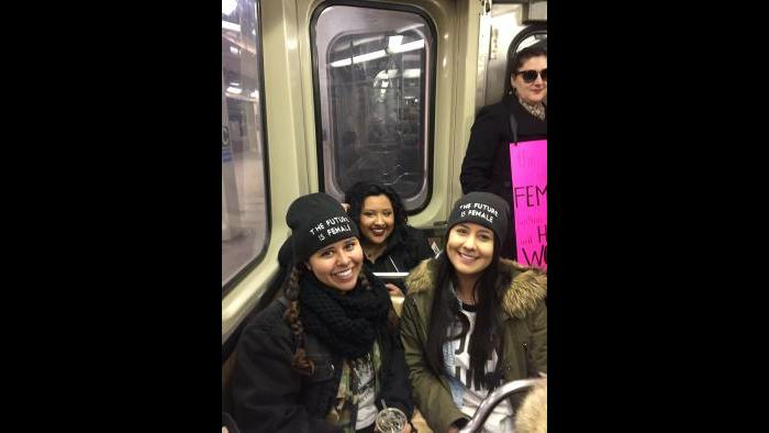 CTA Blue Line train is loaded with activists and their posters en route to the march. (Amanda Vinicky / Chicago Tonight)