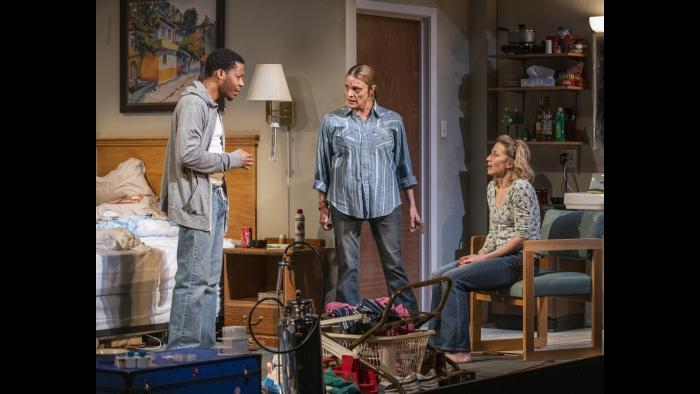 """Namir Smallwood and Carrie Coon in Steppenwolf's production of """"Bug"""" by ensemble member Tracy Letts. (Photo by Michael Brosilow)"""