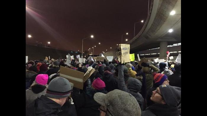 Protesters gather outside Terminal 5 at O'Hare on Saturday. (Paris Schutz / Chicago Tonight)