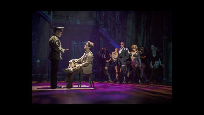 Clifford Bradshaw (Garrett Lutz, seated) is interrogated by a Nazi soldier (Liam Quealy). (Credit: Liz Lauren)
