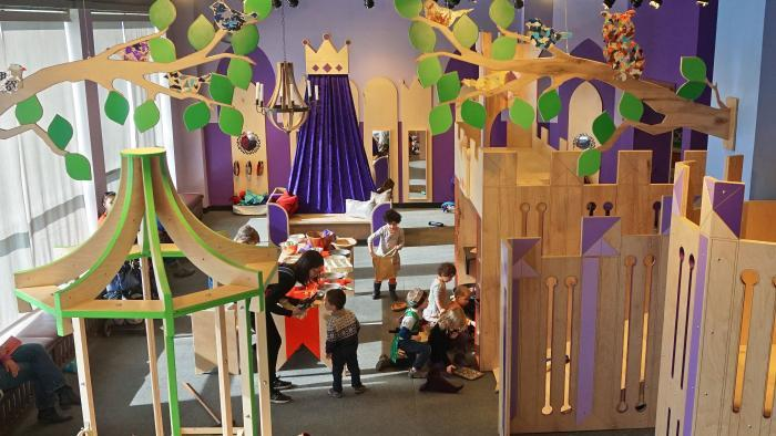 "Children play at the mock kitchen and throughout the ""Once Upon a Castle"" exhibit. (Courtesy of Luci Creative)"