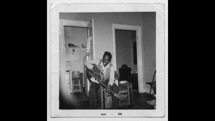 Curtis in his family's Cabrini-Green row house, May 1959. (Courtesy the author's collection)