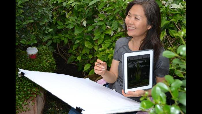 Botanical artist Heeyoung Kim sketching Alice (Photo / Chloe Riley)