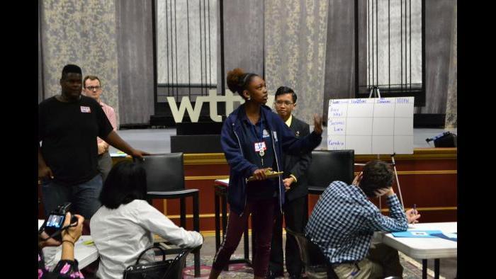 Kenedra Hood (center) delivers her gubernatorial campaign speech during an activity. (Kristen Thometz / Chicago Tonight)