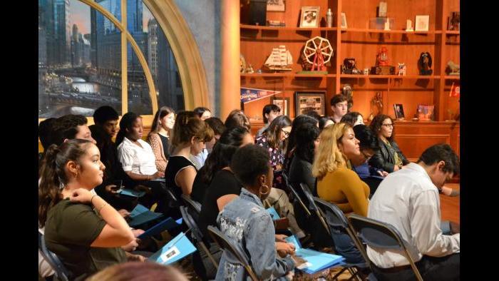 Mikva Challenge students wait for J.B. Pritzker to arrive on set. (Kristen Thometz / Chicago Tonight)