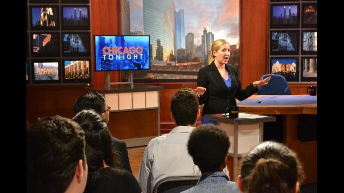 Amanda Vinicky talks to Mikva Challenge students before the forum on Monday, Oct. 8, 2018. (Kristen Thometz / Chicago Tonight)