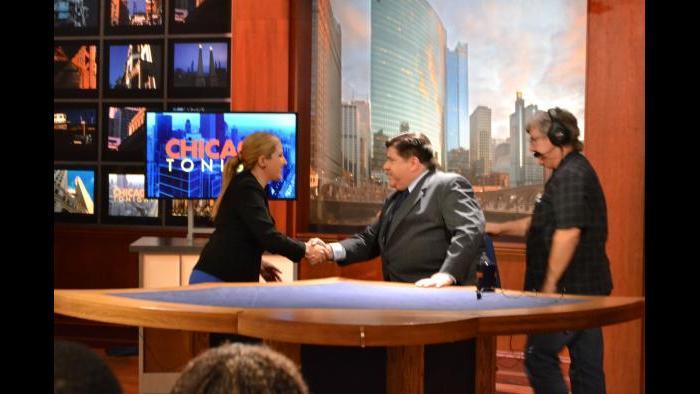 Amanda Vinicky and J.B. Pritzker shake hands before Monday's forum. (Kristen Thometz / Chicago Tonight)