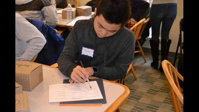 Mikva Challenge student Victor Shi identifies values that are important to him in a candidate.  (Kristen Thometz / Chicago Tonight)