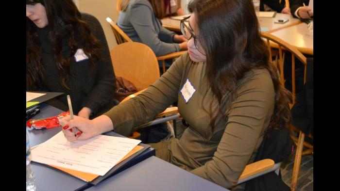 Mikva Challenge student Alejandra Garcia identifies values that are important to her in a candidate.  (Kristen Thometz / Chicago Tonight)