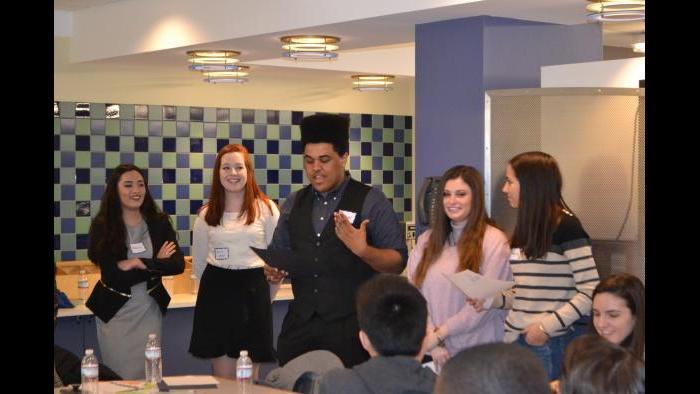 Mikva Challenge student Michael Smith presents his group's campaign public service announcement. (Kristen Thometz / Chicago Tonight)