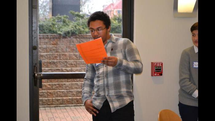 Mikva Challenge student Gerald Sullivan presents his group's campaign public service announcement. (Kristen Thometz / Chicago Tonight)