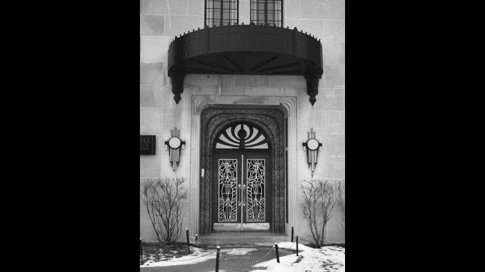 The Powhatan's east entrance on Chicago Beach Drive is adorned with Indian figures standing guard in the grillwork of the doors, flanked by trios of arrows in the light fixtures.
