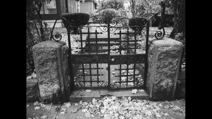 The original stone wall and the wrought iron gate remains on the East 48th street side of the old Charles Hosmer Morse estate. The Richardsonian Romanesque mansion that stood on this wooded lot was demolished in 1931.