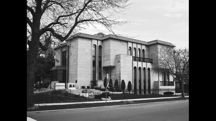 The Muhammad/Farrakhan property featured a curving driveway and tiled fountain facing Woodlawn Avenue. It is guarded by Nation of Islam security and is often photographed by curiosity seekers.