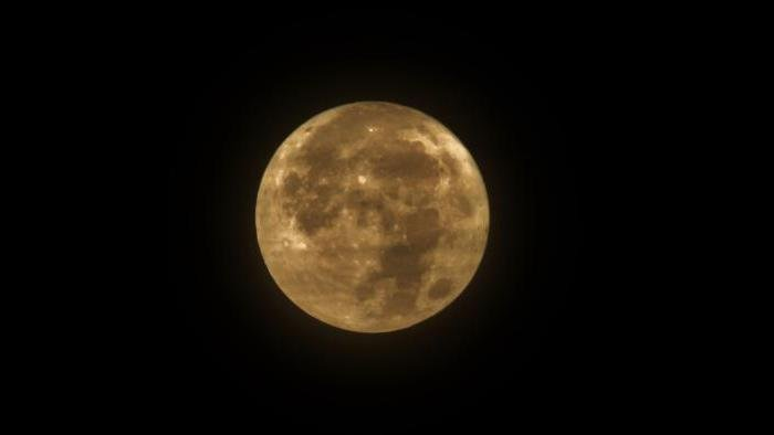 Photo by Debbie Garcy: Taken at Lake Sedgwick, O.P. IL at 5:23 AM as clouds began to cover the Super Moon.