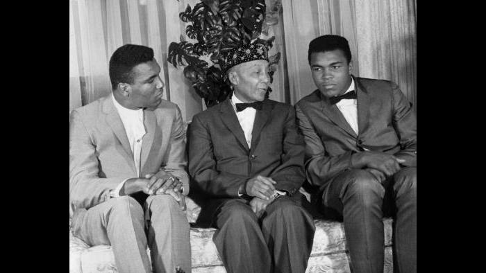After winning the heavyweight title, Ali announced his loyalty to the Nation of Islam and Elijah Muhammad. Elijah honored the boxer with a new name, Muhammad Ali. Rudy Clay, left, also joined the Nation and became Rahaman Ali. (© Lowell K. Riley)