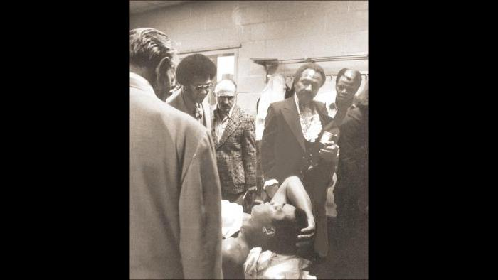 """""""Quit, son, before you get hurt,"""" says Cassius Clay Sr. to his son, in the locker room after the Shavers fight. (© Michael Gaffney Photo)"""