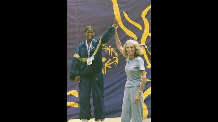 Eunice Kennedy Shriver and an athlete at the 1999 Special Olympics World Summer Games in North Carolina. (Courtesy Special Olympics)