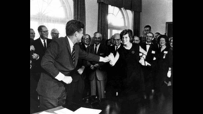 At a bill signing with her brother, President John F. Kennedy. (Courtesy Special Olympics)