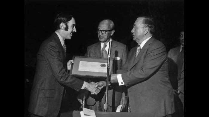 Chuck Renslow (left) receives plaque from Mayor Richard L. Daley commemorating city-council designation of Dewes Mansion as historic landmark, 1974. (Courtesy of Chuck Renslow)