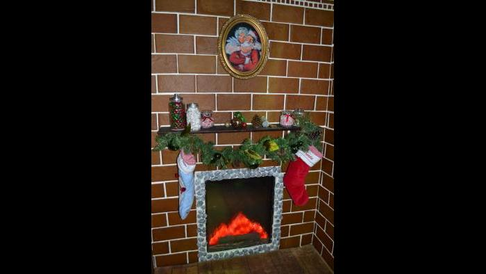 Stockings are hung above the elevator's fireplace, which includes chocolate rocks. (Kristen Thometz / Chicago Tonight)