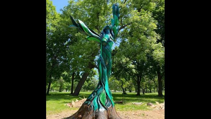 """""""Green Lady's"""" base is unpainted, to emphasize the way she's rooted in the earth. (Chicago Sculpture International)"""