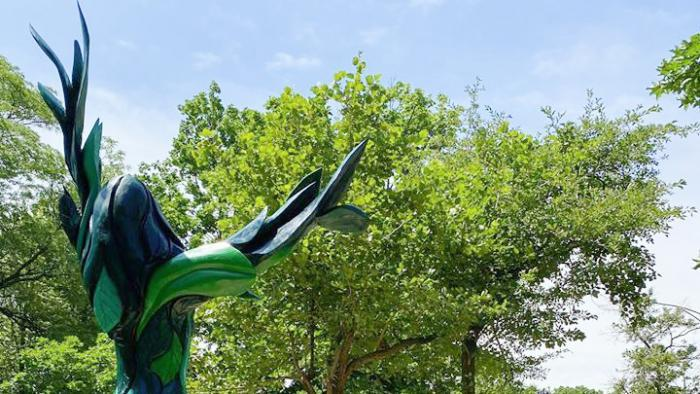 """Sculptor Gary Keenan typically leaves his carvings bare to showcase the wood. """"Green Lady's"""" color gives her a different energy, he said. """"I think it brings her to life more and grabs people's attention easier,"""" said Keenan. (Chicago Sculpture International)"""