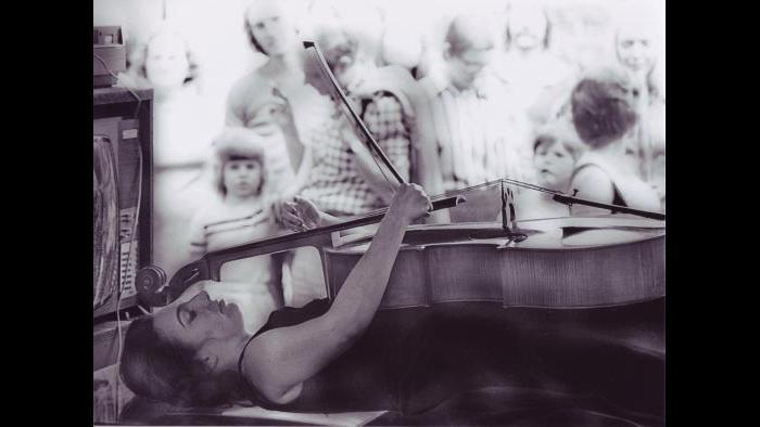 Charlotte Moorman performs Nam June Paik's TV Bed, Bochum Art Week, Bochum, West Germany, August 28–September 3, 1973. (© Hartmut Beifuss)