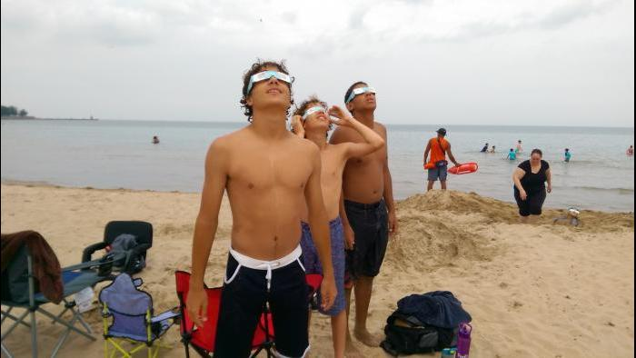 Friends & brothers watching eclipse at Foster beach. (Submitted by: CS Russell)