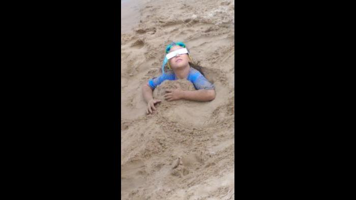When your brothers bury you in 4 foot hole during eclipse. (Submitted by: CS Russell)