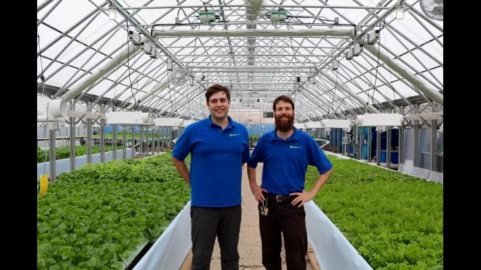 Metropolitan Farms founder and CEO Benjamin Kant, left, and co-founder and COO Shockey Funke inside the Metropolitan Farms greenhouse. (Evan Garcia)
