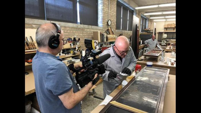 WTTW videographer Tom Siegel films the conservation process of an 18th century Chinese screen.