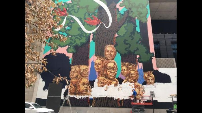 WTTW cameraman Dave Moyer films the progress of Kerry James Marshall's largest work to date.