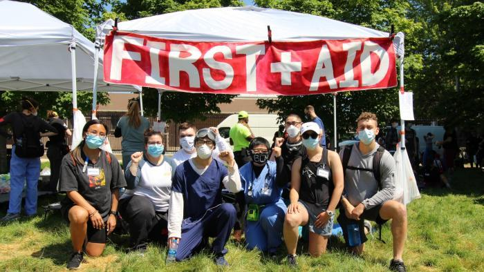 Health care workers volunteering as street medics set up a first aid tent during a rally held June 6, 2020 in Union Park. (Courtesy Dakota Lane)