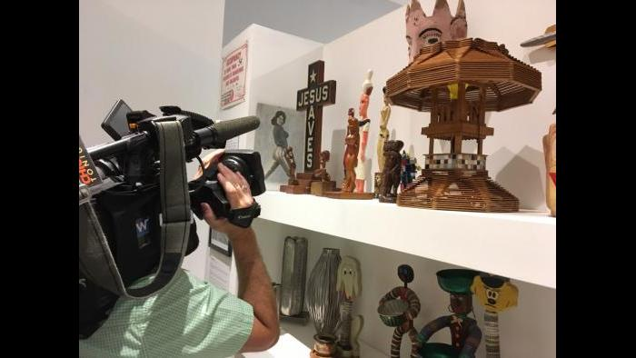 "WTTW cameraman Felix Mendez on our shoot at Intuit's ""Chicago Calling"" exhibition."