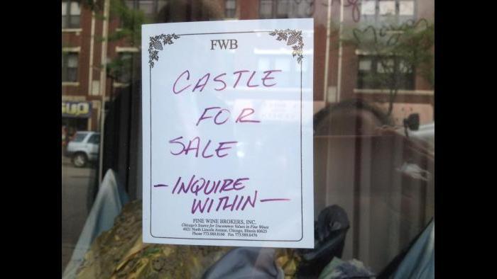 Sign advertising Fine Wine Brokers' cork castle window display (Rebecca Palmore / Chicago Tonight)