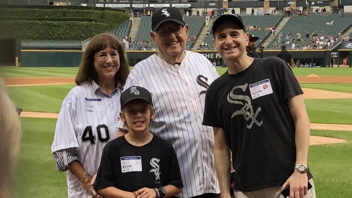 Analee, Holden, Joel and Matthew Weisman on the field Monday, Aug. 6, 2018, before Joel throws out the ceremonial first pitch.