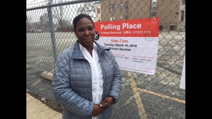 Brenda Bunch poses outside her 20th Ward polling place on Tuesday morning. (Eddie Arruza)
