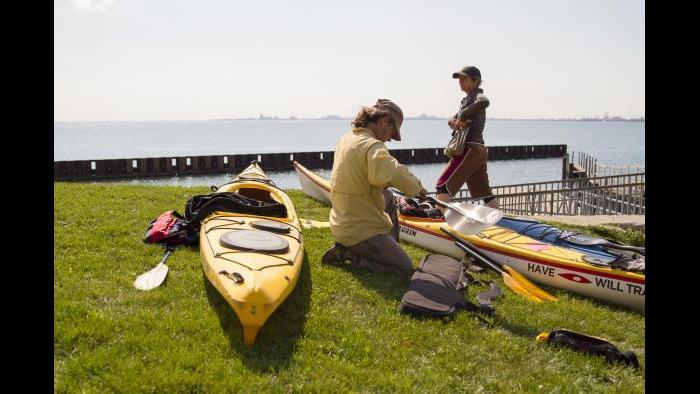Planning for our paddle along the Calumet River. (Luke Brodarick / Chicago Tonight)