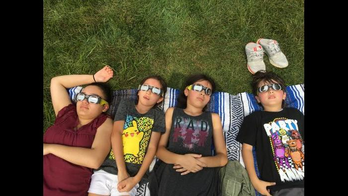 Siblings enjoying the eclipse! What a wonderful sight! (Submitted by: Theresa Martinez)