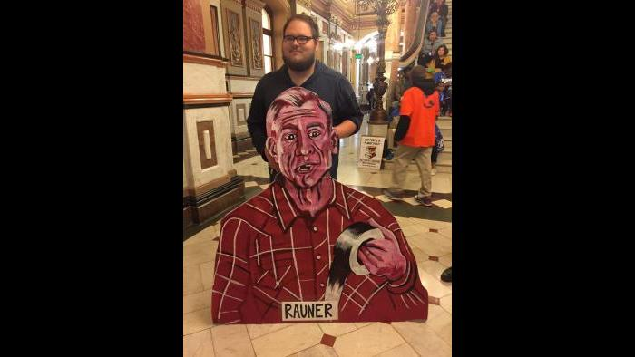 Protesters demanding a budget block Gov. Bruce Rauner's office on Tuesday.
