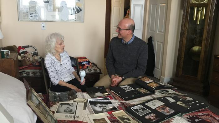 Dorothy Olson Pauletti looks though her photo albums with Jay Shefsky.